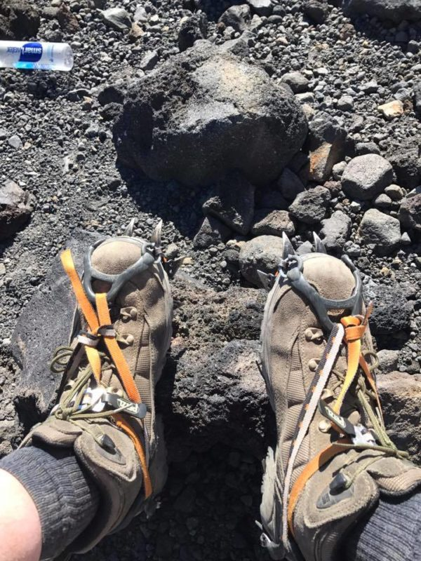 Crampons on, getting ready to climb the snow on Mt. Adams