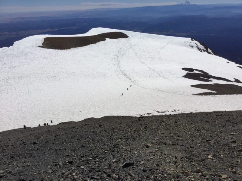 Group descenging Mt. Adams, walking across snowfield from the summit to Piker's Peak false summit