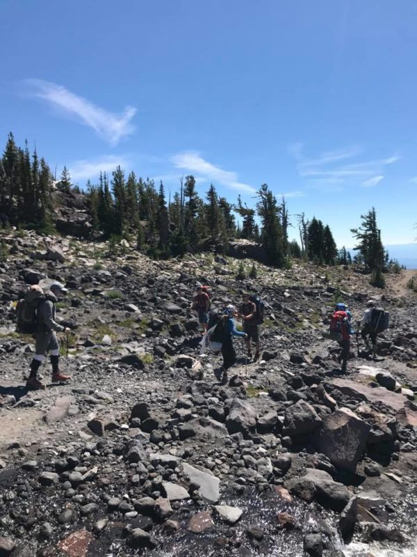 Young men hiking up Morrison Creek drainage on Mt. Adams